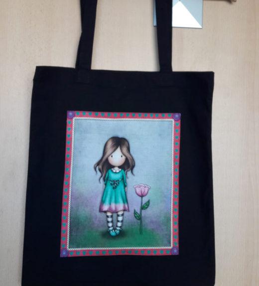 Černá plátěná taška s motivem panenky s květinou